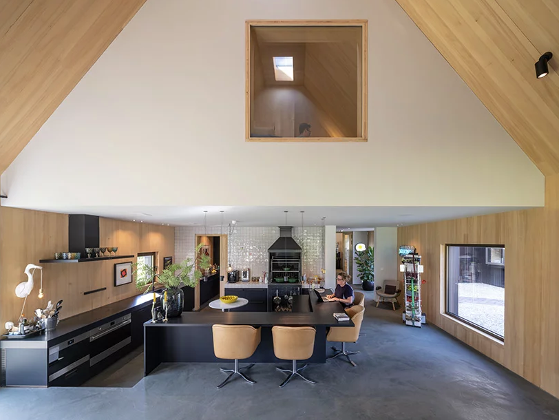 The kitchen and dining spaces are united and there's a platform to divide them a little bit
