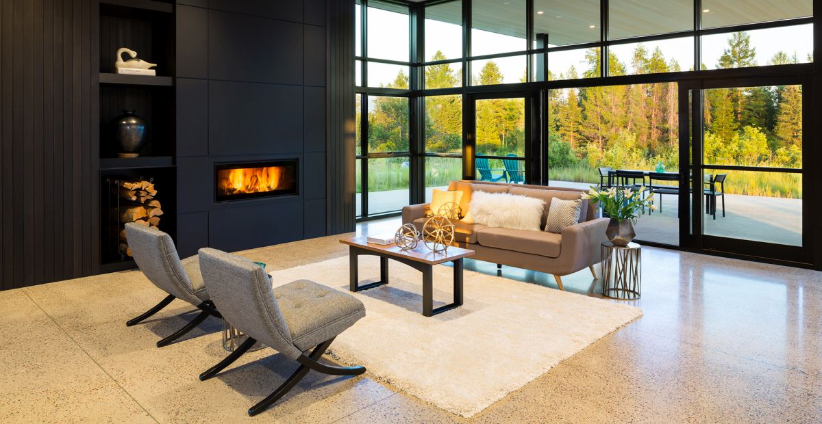 The living room is done with a built in fireplace, a glazed wall and some stylish furniture