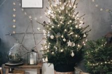04 a Christmas tree with lights, white ornaments, baskets, a star garland and a star of twigs