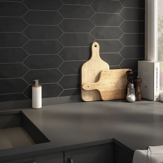a black honeycomb tile backsplash with white grout is a creative idea that fits minimalist spaces