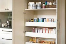 04 a neutral built-in pantry doesn't stand out a lot from the overall kitchen decor and gives much storage space