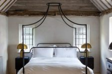04 a quirky canopy bed in black on tall legs is a great idea for an eclectic room like this one