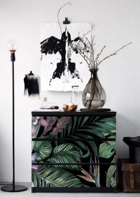 a simple Malm piece is updated using moody tropical contact paper looks very trendy