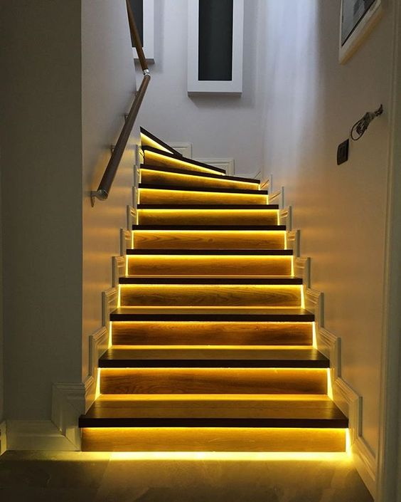 highlight your staircase with built-in lights - this way you won't need to hang any lights over the steps