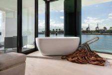 a contemporary minimalist bathroom design with views