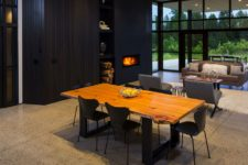 05 The dining space is right here, with a live edge table and black chairs