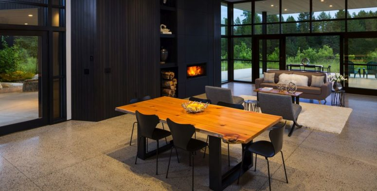 The dining space is right here, with a live edge table and black chairs