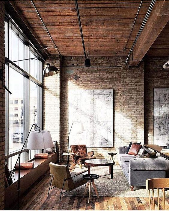 a chic industrial meets vintage living room with exposed metal and refined furniture