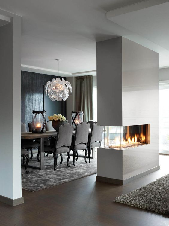 a sleek white minimalist double-sided fireplace will give a chic look to the space and make it cozy