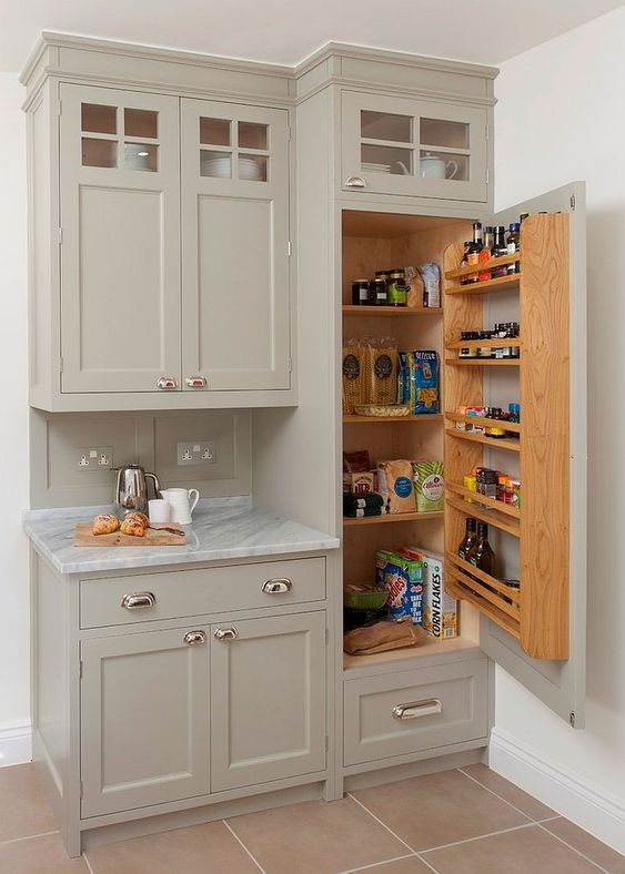 a small built-in pantry with some shelves inside and on the door is a cool idea for a tiny kitchen