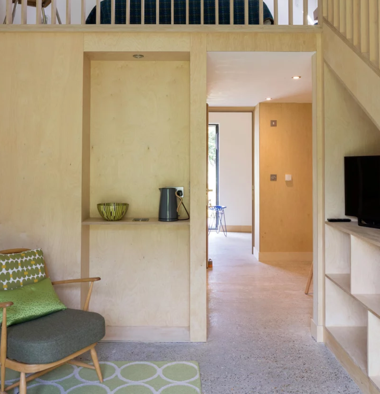 Much plywood adds coziness, there is plenty of storage space and a loft bedroom under the skylight