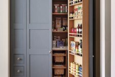 06 a built-in pantry with lots of basket drawers, shelves on the doors and inside is a cool idea to use an awkward nook