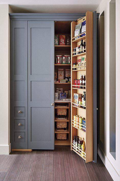 a built-in pantry with lots of basket drawers, shelves on the doors and inside is a cool idea to use an awkward nook