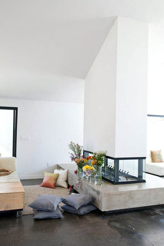 a stylish white double-sided fireplace with a glass part and a concrete one is a chic idea for a contemporary home