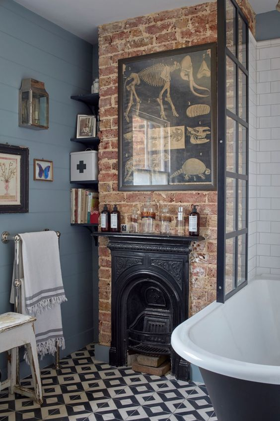 a touch of brick in the bathroom with a faux fireplace will instantly give it an industrial and vintage feel