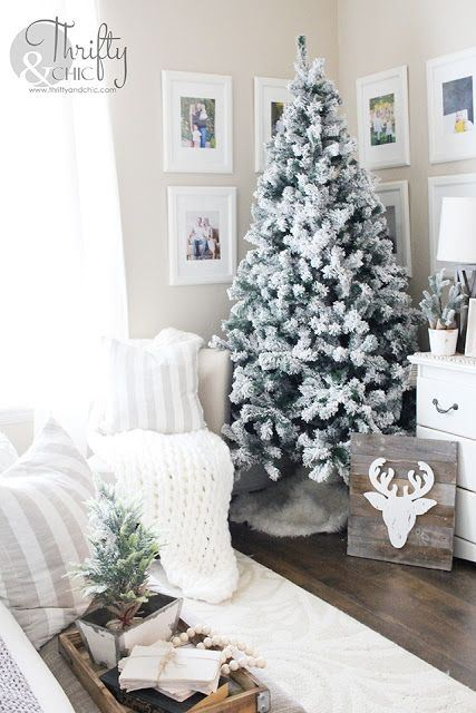 winter farmhouse decor with a flocked Christmas tree, a deer sign, a mini Christmas tree and wooden beads