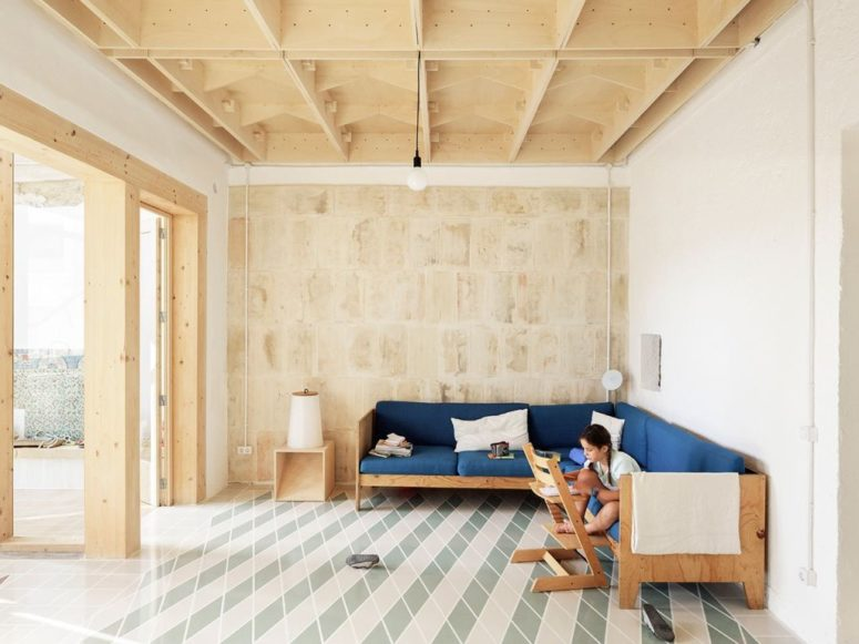 The living room shows off some stylish furniture of plywood and tiles on the floor