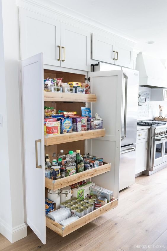 a neutral built-in pantry with pull-out drawers only is a cool idea with maximal functionality