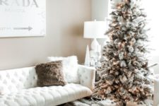 07 a snowy Christmas tree with pinecones and lights and some white branches on top, candles and fluffy pillows