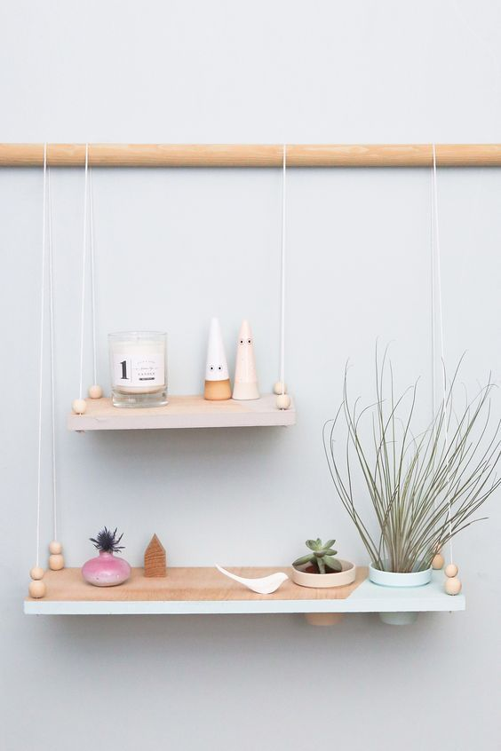 minimalist hanging shelves - two color block ones with a pastel edge on a wooden holder