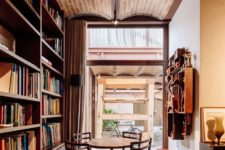 a cozy reading nook with large bookcases