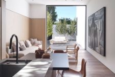 08 The second living room opens to an outdoor living room with comfy furniture