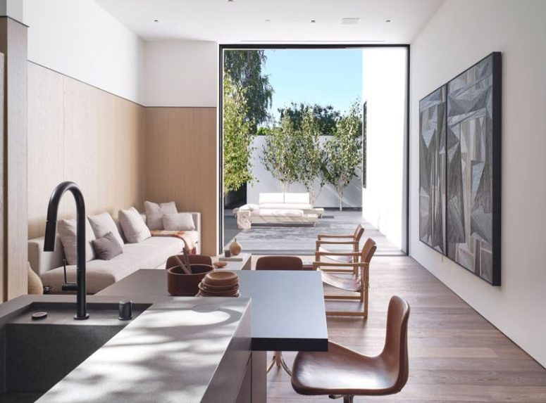 The second living room opens to an outdoor living room with comfy furniture