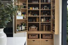 08 a large built-in pantry with neutral shelves, drawers and baskets feels and looks rustic