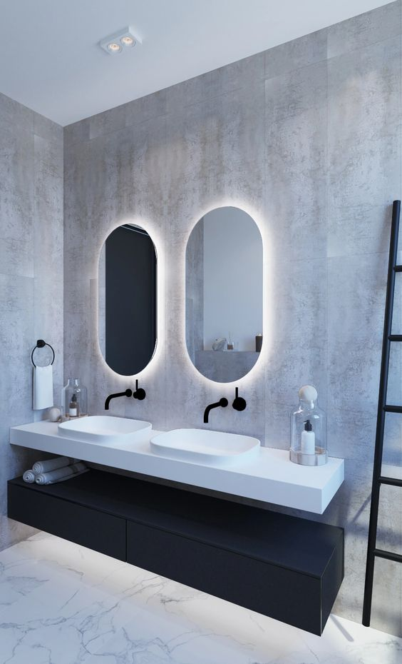 a minimalist bathroom highlighted with backlighting behind the mirrors looks bolder and brighter