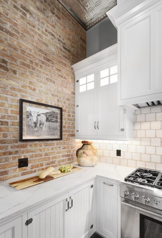 a neutral brick wall will give less color to the space but not less texture, so it's a cool idea