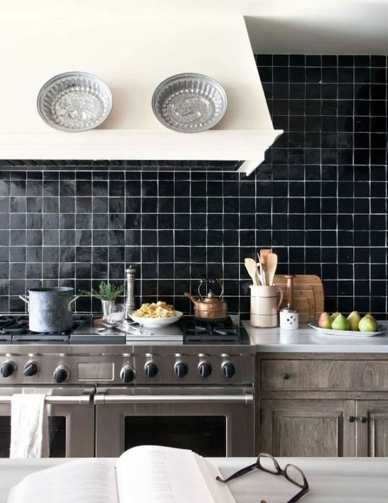 a shiny black tile backsplash with white grout is a statement idea for any kitchen with a retro feel