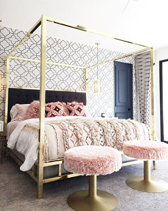 a super glam and shiny gold canopy bed will add a sparkly and chic touch to the bedroom, and brass stools continue the decor theme