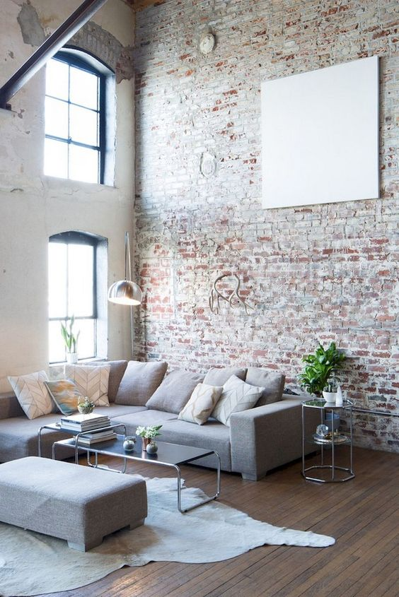 a neutral brick wall and factory-like windows make the space feel more industrial and more catchy