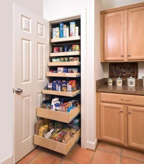 a small built-in pantry with pull out shelves is a super functional idea that is a great fir for small spaces - you'll use every inch