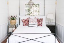 09 a very elegant and chic black canopy bed with gilded touches and a Moroccan pendant lamp over the bed