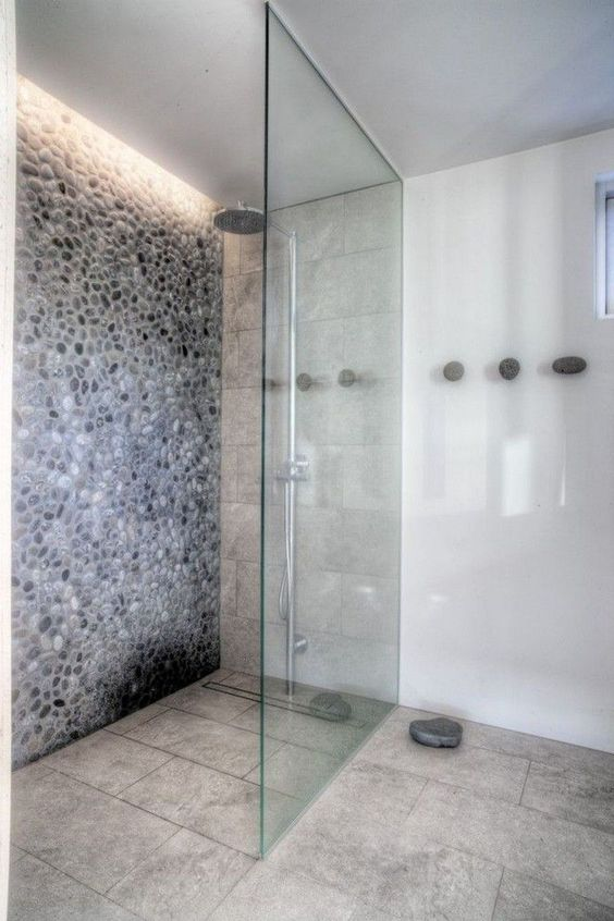 add built-in lights to the shower space to create a feeling of a skylight and make it more welcoming