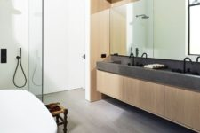 10 The master bathroom is contemporary, with a sleek vanity and a stone countertop plus a bathtub