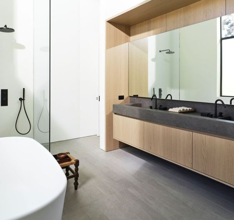 The master bathroom is contemporary, with a sleek vanity and a stone countertop plus a bathtub