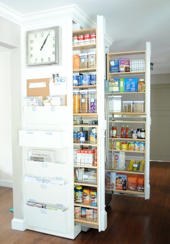 a mini built in pantry with rolling out shelving units   here you can store lots of things easily