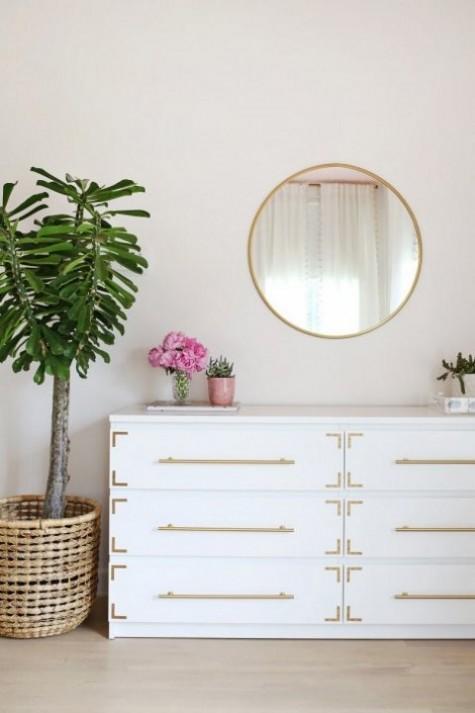 an IKEA Songesand dresser hack with gold pulls and corner braces is a timelessly chic piece
