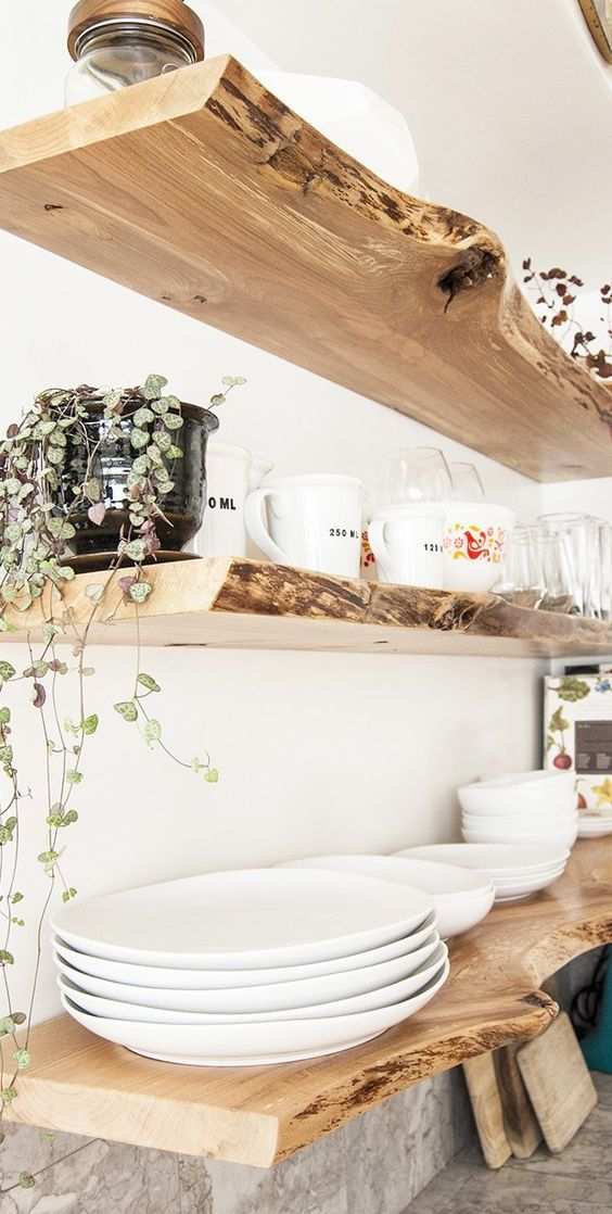 raw edge floating shelves to make a statement in the kitchen - such shelves is super trendy and popular