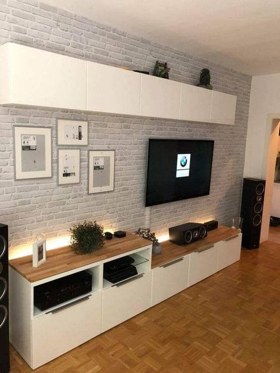 some additional lights accent this TV unit and make this space more eye-catching