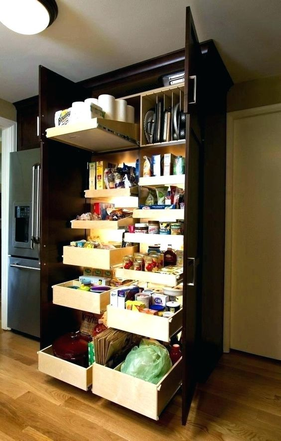 a dark built-in pantry with pull out shelves and drawers and additional lights help you find everything