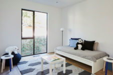 12 The second kid's room is also rather minimal but with a comfy rug and colorful pillows