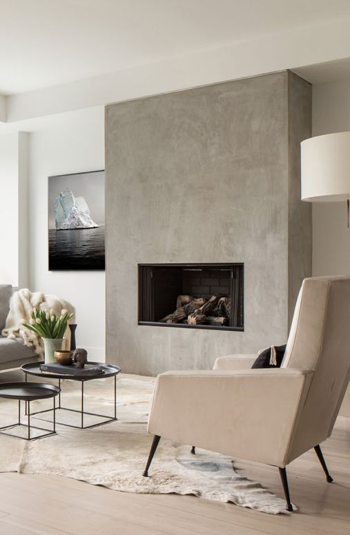 a minimalist fireplace built-in seamlessly into the concrete wall is a chic idea to add eye-catchiness