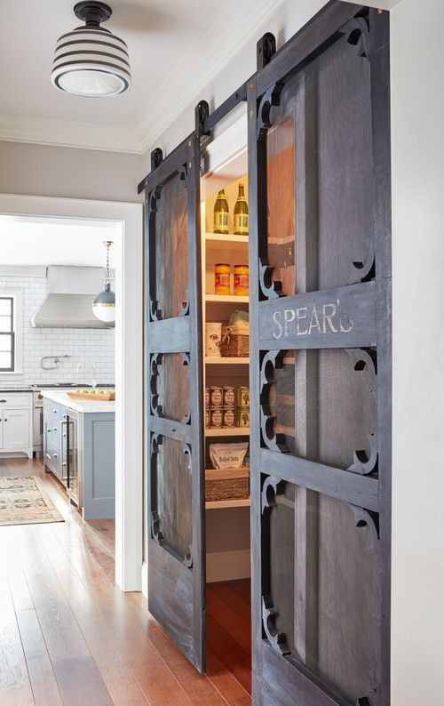 a pantry with whimsy barn-inspired sliding doors, which are a cool idea to save some space