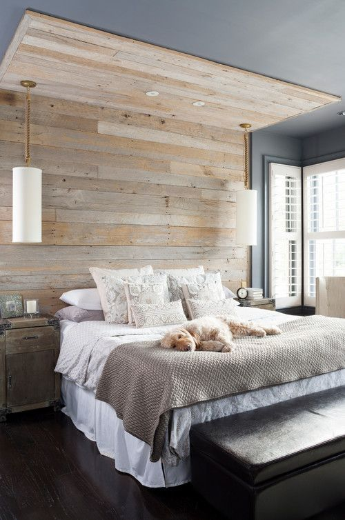 a reclaimed wooden wall and ceiling part make the bedroom feel cozier and a bit industrial