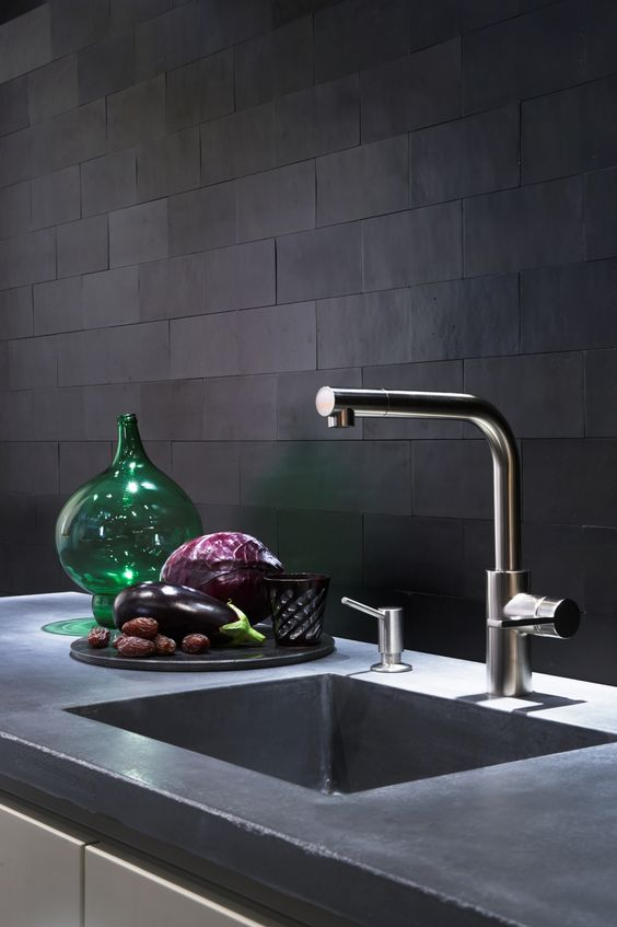 matte black tiles with mathcing grout look very unusual and textural adding interest to the space