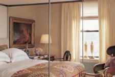 14 a chic canopy bed with a fabric cover that reminds of the Middle Ages and gives elegance to the bedroom
