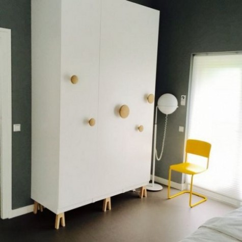 an IKEA Pax wardrobe hack with Muuto dots and Superfront legs looks very eye-catchy, whimsical and funny